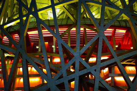 Beijing, China - April 26, 2011: The Beijing National Stadium( the Birds Nest) lights up. As a landmark of modern China, which attracting million of tourists each year.