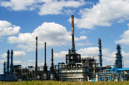 Oil refinery factory against blue sky Stock Photo