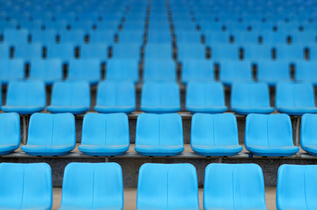 Rows of stadium grandstand seats Stock Photo