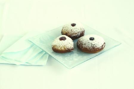 jewish cuisine: Hanuka Jelly Doughnuts on isolated plate  Stock Photo