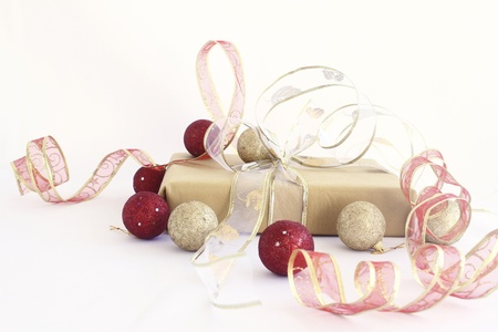 Christmas gift with gold and red ribbons photo