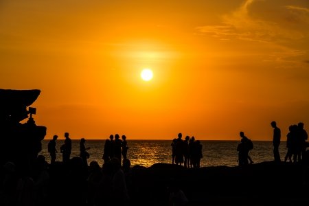 sunset at Tanahlot temple bali indonesia Stock Photo