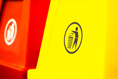 environmental protection: Yellow garbage pail with sign