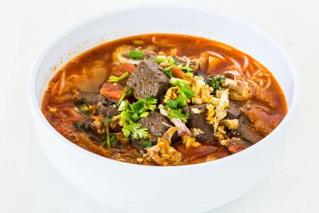 Thai noodle or kanomsen on white plate, chiangmai Thailand Stock Photo