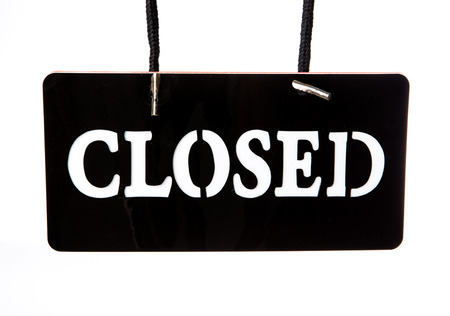 closed signboard on white background photo