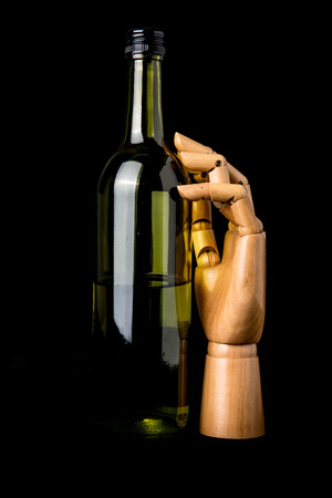 wooden hand with bottle photo