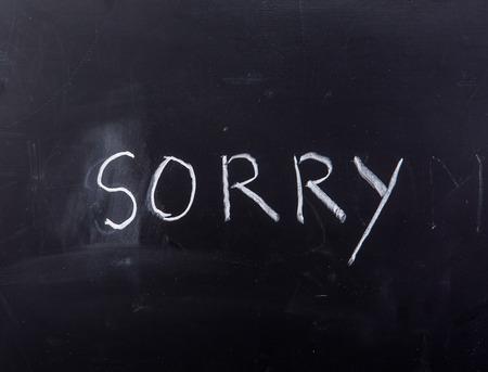 apologize: word sorry on blackboard Stock Photo