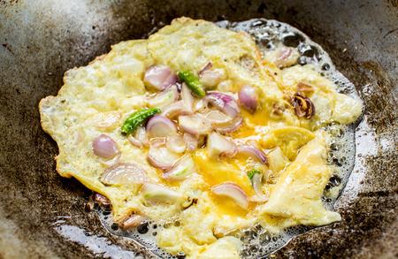 omlet: frying omlet in pan. Stock Photo