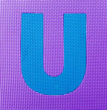 letter U on purple background Stock Photo