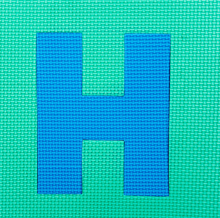 letter H on green  background Stock Photo