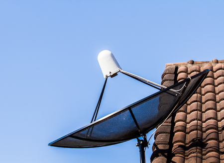 sattelite: sattelite dish on roof