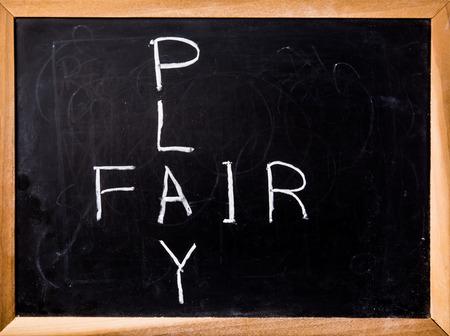 fair play: fair play word on black board Stock Photo