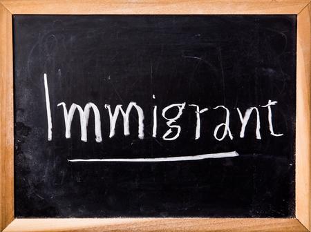 immigrant: immigrant word on blackboard