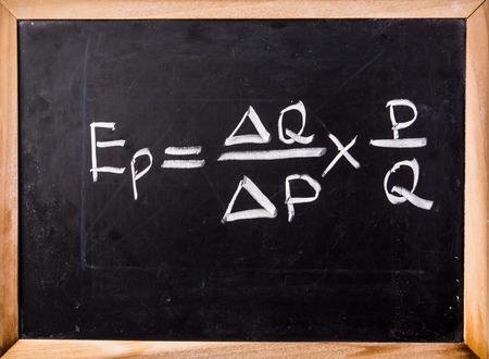 equation: economics equation on blackboard