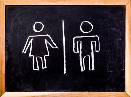 toilet symbol: toilet symbol on black board Stock Photo