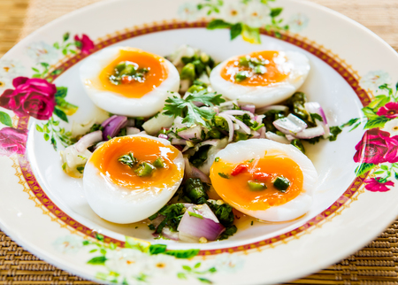 medium-boiled egg with salad
