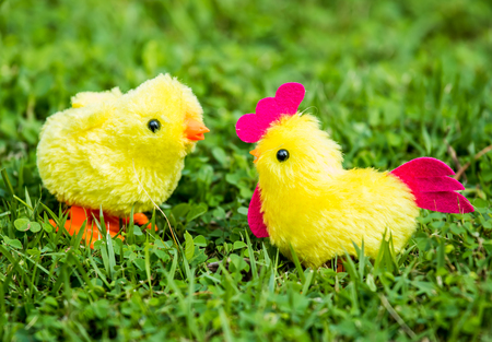 holiday: chicken  toy   in the grass Stock Photo