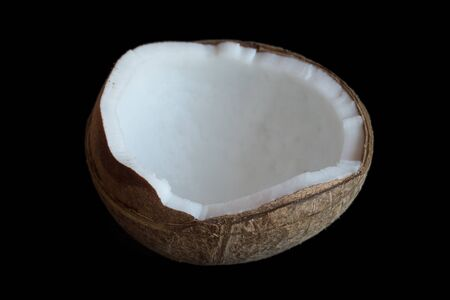 Half coconut isolate on a black background. selective focus