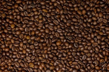 Background of coffee beans. Top view. Close up