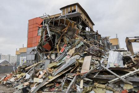 disrupt: Excavator destroys building Editorial