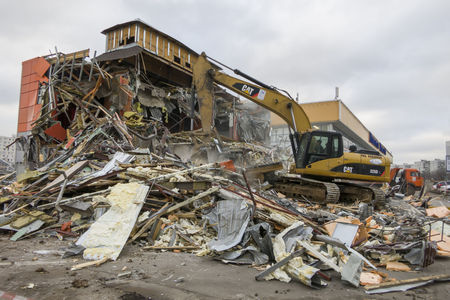 disrupt: Moscow, Russia - February 11, 2016: Excavator destroys building