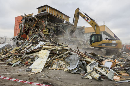 disrupt: Moscow, Russia - February 11, 2016: Excavator demolishes building