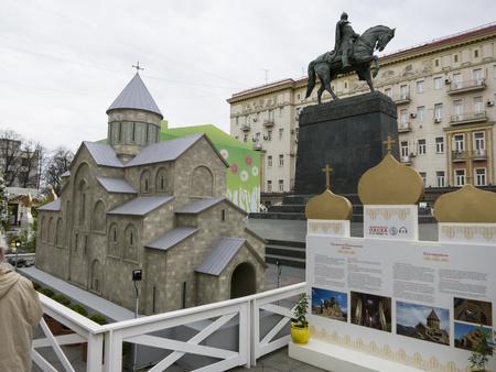 yuri: Moscow, Russia - April 28, 2016: Decorations for Easter Day. Model of Svetitskhoveli Cathedral - Georgian Orthodox Church. Monument to Yuri Dolgorukiy.
