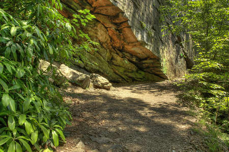 Massive stone wall and cave along the path to Lehigh Valley Gorge- Pa Stock Photo - 14081214