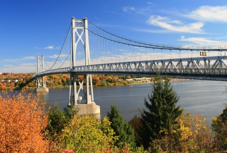 Mid Hudson Bridge at fall looking across the Hudson River from Highland to Poughkeepsie - New York
