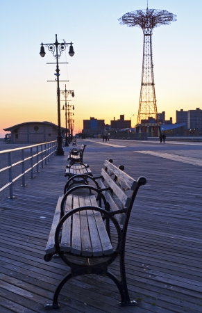 Benches on the Coney Island Boardwalk at dusk  with the Parachute Drop in the background photo