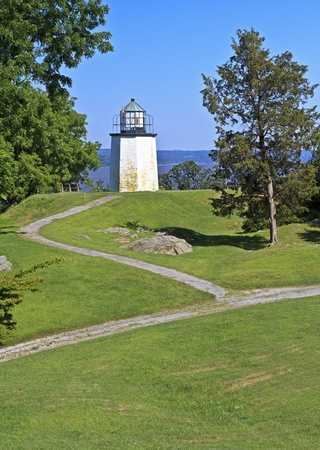 grassy knoll: Stony Point Lighthouse on a grassy knoll overlooking the Hudson River in New York State Stock Photo