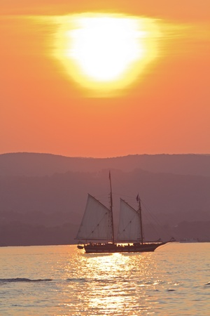 The Schooner Mystic Whaler on a sunset cruise on the Hudson River off Croton Point Park during the 2011