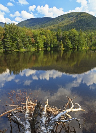 Pehlps Mountain reflected in Marcy Dam Pond in the High Peaks region of the Adirondack Mountains of New York Stock Photo