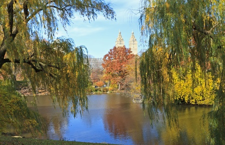 The El Dorado building seen between two willow trees on the lake in Central Park in New York City photo