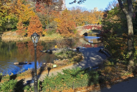 The bridge over the Central Park Pond surrounded by Autumn splendour in New York City photo