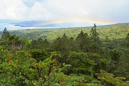 A rainbow over Lake Arenal in Arenal National Park, Costa Rica photo