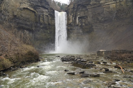 Wide view from below 215' tall Taughannock falls near Ithaca, NY - the tallest free falling waterfall in the Northeast U.S. Stock Photo - 11773361