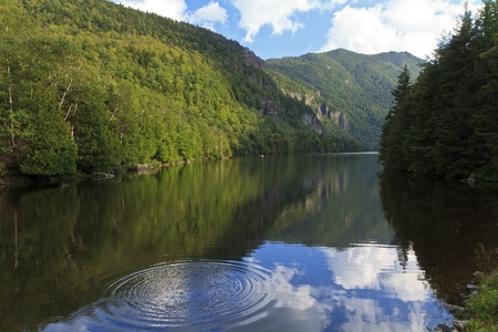 Concentric ripples on Lower Ausable Lake on a sunny afternoon in the Adirondack State Park