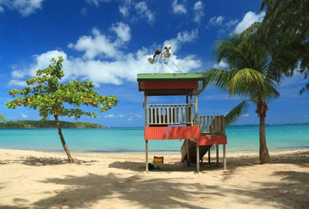 A lifeguard post stands in front of a calm aqua bay at Seven Seas Beach near Fajardo, Puerto Rico photo