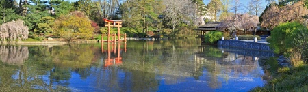 A panoramic view of the Japanese Hill-and-Pond Garden at the Brooklyn Botanic Gardens on a sunny Spring morning. Stock Photo