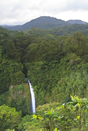 High resolution panorama of La Fortuna Waterfall against the forested cliff in the Arenal Mountains of Costa Rica
