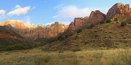 Panorama view of the Towers of the Virgin as the morning clouds burn off in Zion National Park, Utah photo
