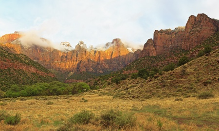 Panorama view of the Towers of the Virgin in the morning clouds in Zion National Park, Utah photo