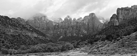 Black and white panorama view of the Towers of the Virgin in the morning clouds in Zion National Park, Utah photo
