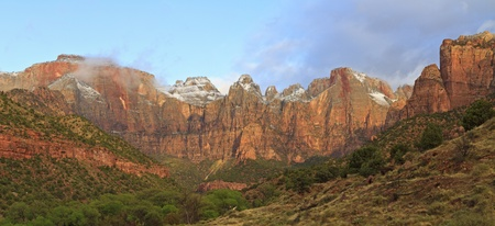 cottonwood canyon: Wide view of the Towers of the Virgin as the morning clouds burn off in Zion National Park, Utah Stock Photo