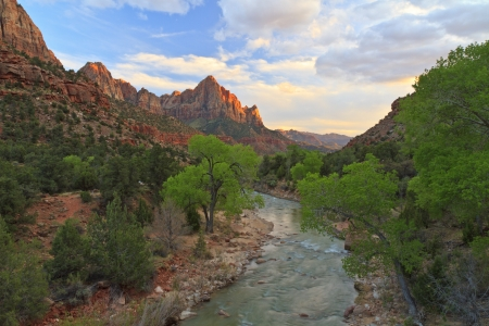 The last rays of sun hit The Watchman mountain with the Virgin River in the foreground in ZIon National Park, Utah photo