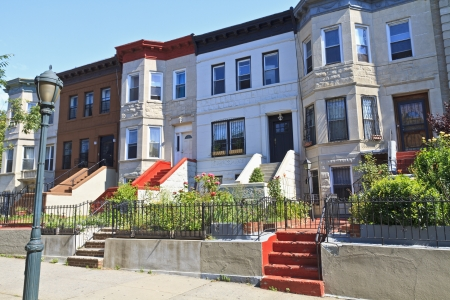 stoop: A row of attached apartment buildings on Eastern Parkway in the Crown Heights neighborhood of Brooklyn, NY Stock Photo