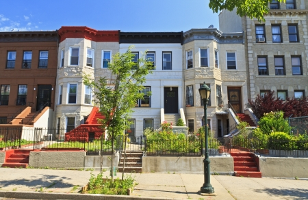 brownstone: A row of attached apartment buildings on Eastern Parkway in the Crown Heights neighborhood of Brooklyn, NY Stock Photo