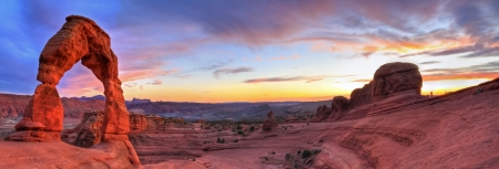 arches national park: Sweeping sunset panoramic view of famous Delicate Arch in Arches National Park in Moab, Utah (HDR) Stock Photo
