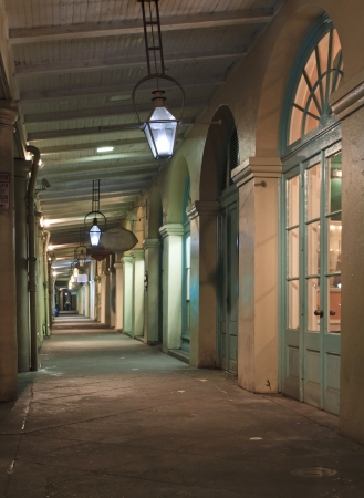 Nighttime view of the walkway in the French Market in New Orleans, Louisiana photo